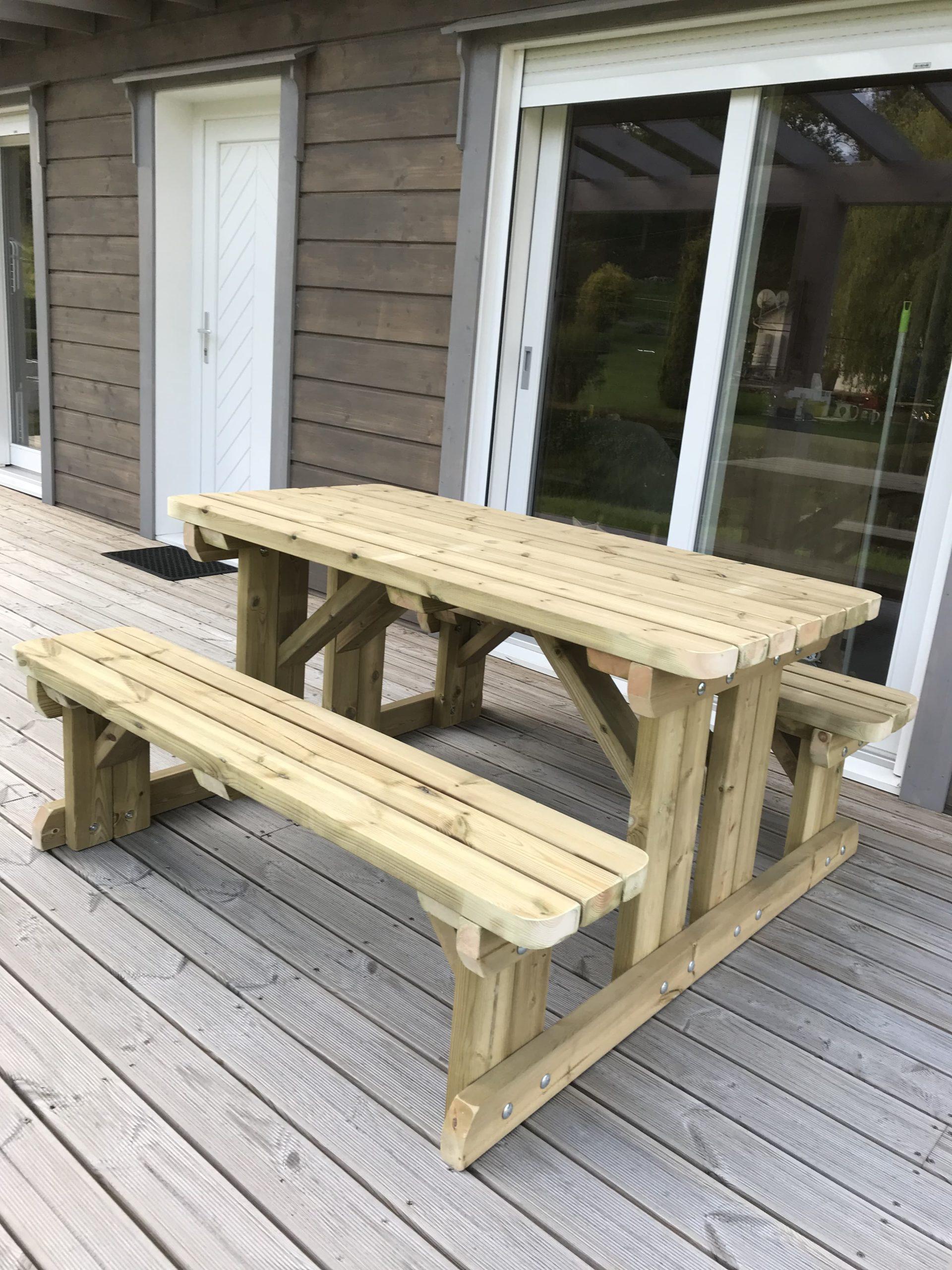 a walk in pub bench on wooden decking