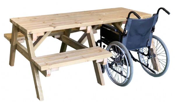 side view of wheelchair accessible pub bench with wheelchair pushed in the right side of table