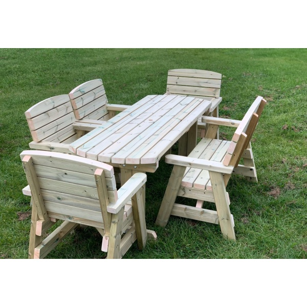 side view of a six seater outdoor dining set with one wooden bench and four single wooden chairs