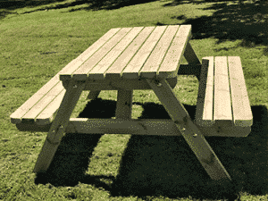 a standard wooden picnic table in the garden