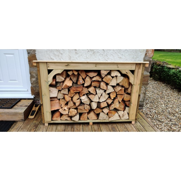 The Coppice log store with logs in garden